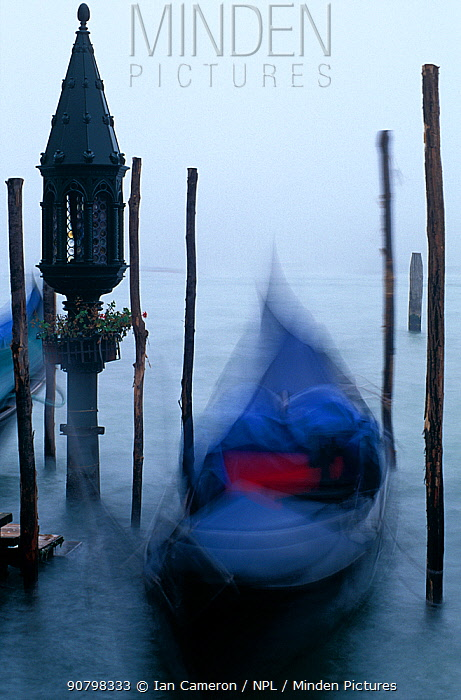Slow exposure of a gondola moored at dawn in the fog. Grand Canal, St Marks Square, Venice, Italy.