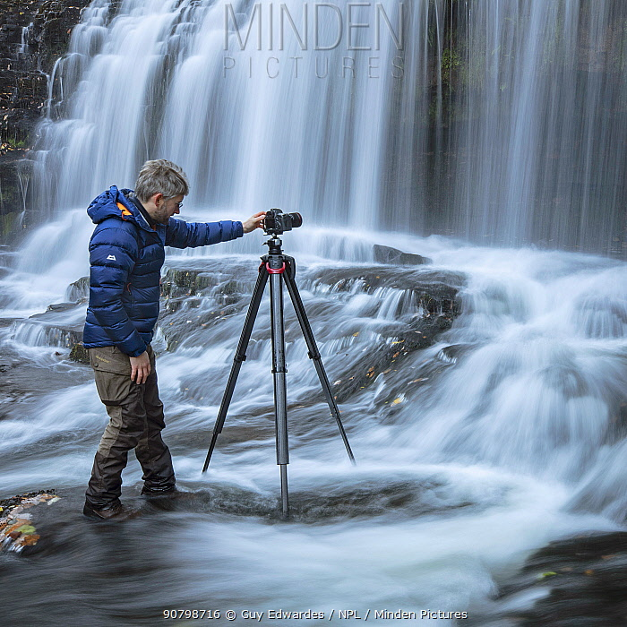 Photographer Guy Edwardes working in river in the Brecon Beacons, Wales, UK, October 2018.