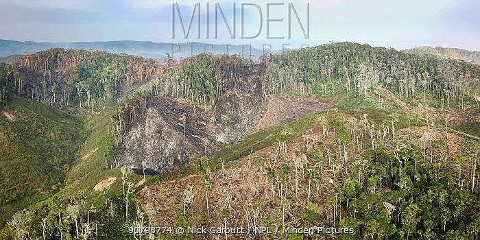 Deforestation of mid-altitude rainforest, high angle view. Near Andasibe-Mantadia National Park, eastern Madagascar. October 2017.