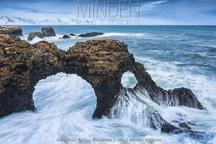 Natural sea arch with long exposure of waves, Gatklettur, Arnarstapi, Iceland. December 2013