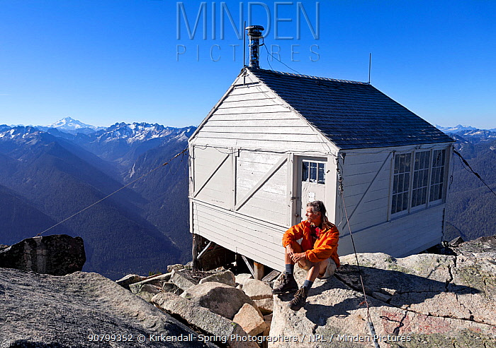 Photographer Tom Kirkendall sitting outside Hidden Lake Lookout, Mount Baker Snoqualmie National Forest, Washington, USA, September 2014. Model released