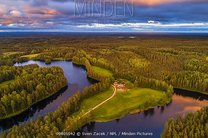 Aerial view of dwelling between two lakes, surrounded by forest. Karula National Park, Vorumaa, Southern Estonia. June 2018.