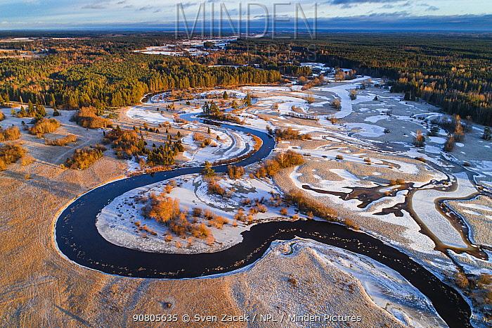 Meandering Mustjogi river with frozen lakes, aerial view. Border with Latvia. Valgamaa, Estonia. December 2016.