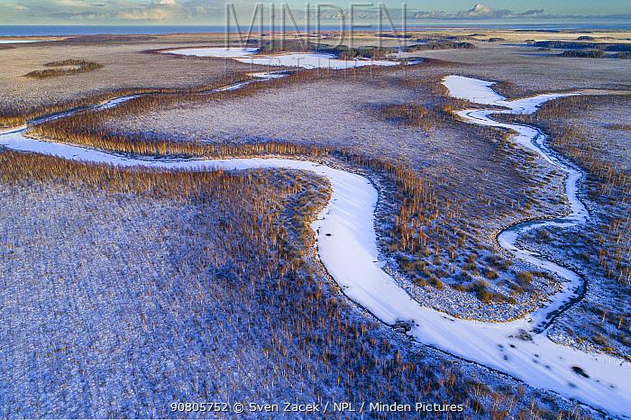 Frozen and snow covered Kalli River and Kalli Lake with Lake Peipsi / Peipus in background. Emajoe Suursoo Nature Reserve, Tartumaa, Southern Estonia. November 2018.