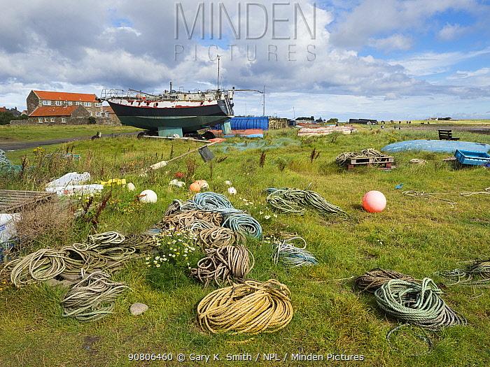 Boats and fishing equipment on Lindisfarne, Northumberland, England, UK, September 2017.