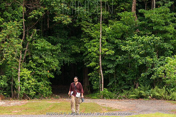 The entrance to the Daintree Rainforest Observatory's highly studied forest with Dr. Alex Cheesman coming out after collecting data from the trees.Queensland, Australia. February 2015