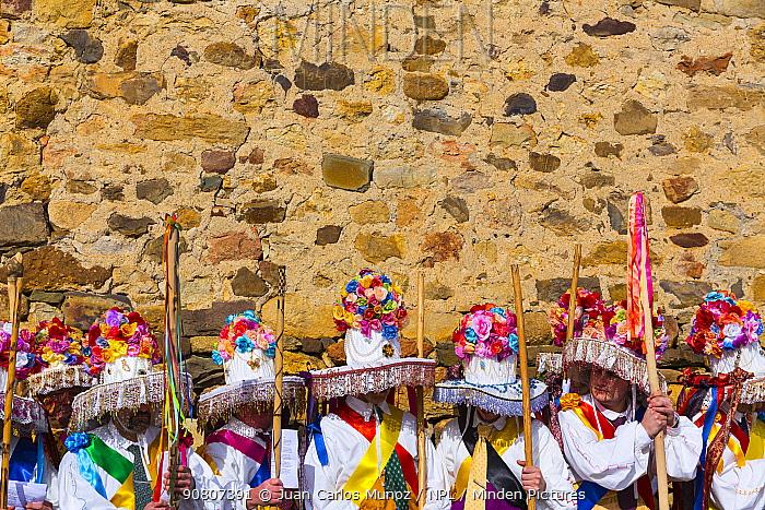 Men in colourful costumes at Carnival of Zamarrones, Belmonte village, Polaciones valley, Cantabria, Spain. February 2013.