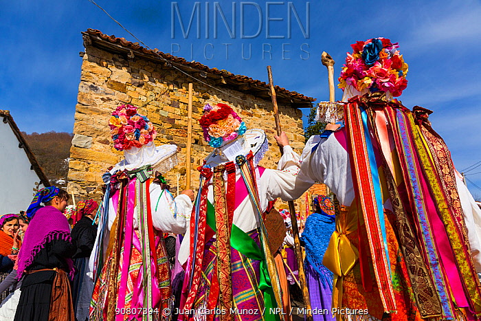 Men in colourful costumes at Carnival of Zamarrones, Belmonte village, Polaciones valley, Cantabria, Spain.