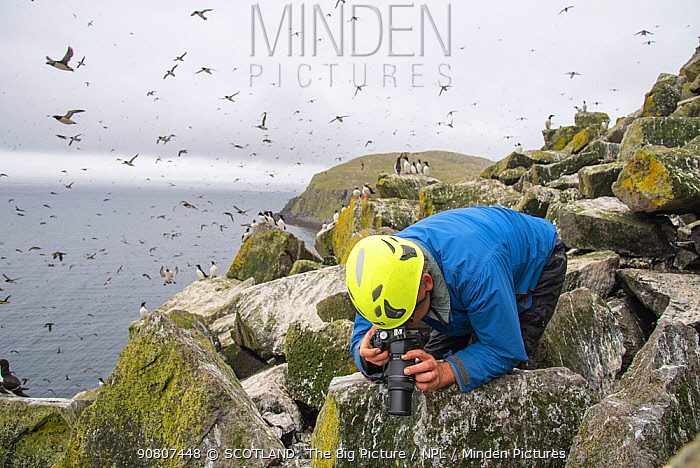 Glasgow University seabird researcher Dr Ruedi Nager documenting plastic in birds' nests, Shiant Isles, Outer Hebrides, Scotland, UK. July, 2018.