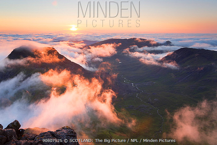 Evening view from Askival mountain over inversion layer and the Atlantic corrie, Isle of Rum, Hebrides, Scotland, UK, September.