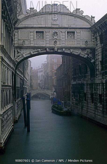 Misty morning over the Bridge of Sighs in St Mark's Square, Venice, Italy. Lord Byron popularised the belief that the bridge's name was inspired by the sighs of condemned prisoners as they were led through it to the executioner.