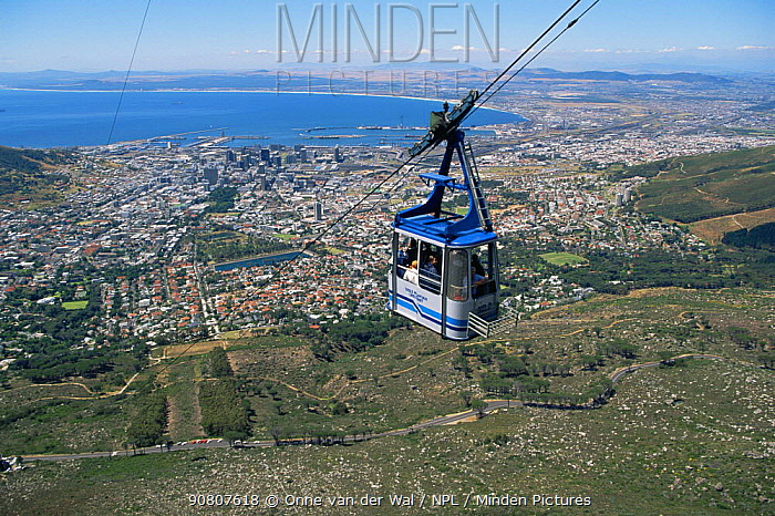 Cable car ride to the top of Table Mountain with a vast view across Cape Town, South Africa.