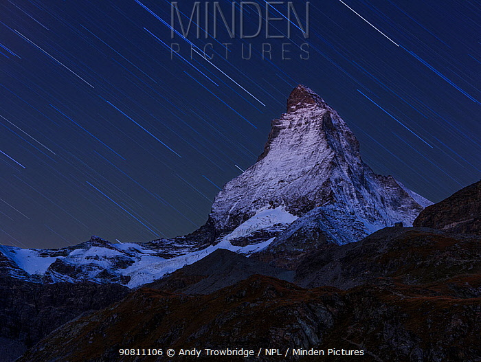 Matterhorn (height 4,478m) at night, with star trail, taken from Schwarzsee. Zermatt, Switzerland, September 2012. Composite image.