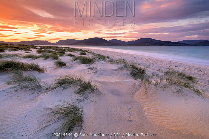 Luskentye beach at sunrise, mountains and incoming tide, Isle of Lewis and Harris, Outer Hebrides, Scotland, UK. October 2018.