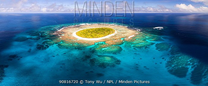 Aerial panorama of Fangasito Island in the Vava'u island, Kingdom of Tonga, showing fringing coral reef structure and white sand beaches around the island.