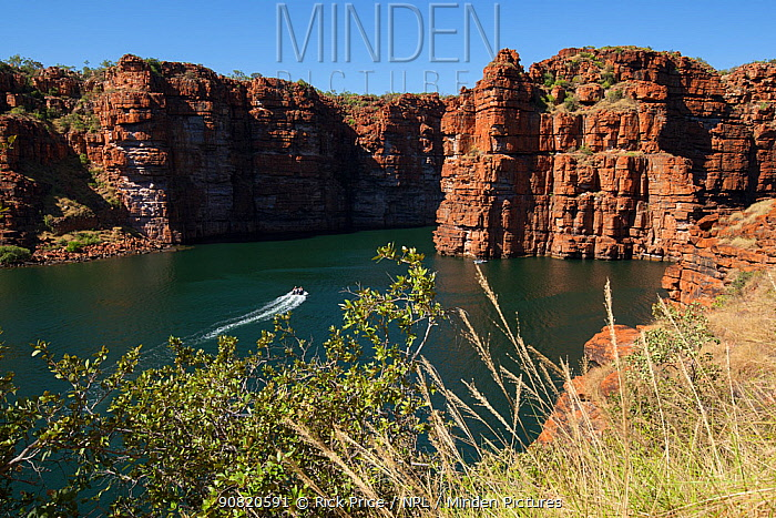 Zodiac boat with tourists approaching site of waterfalls of King George River, during dry season. Koolama Bay, The Kimberley, Western Australia. July 2015.