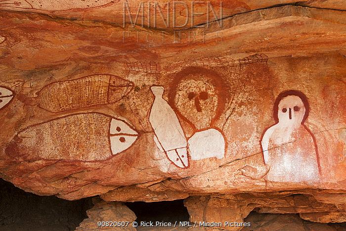 Wandjina style Aboriginal rock art, depiction of people and fish. Raft Point, Doubtful Bay, The Kimberley, Western Australia. 2016.