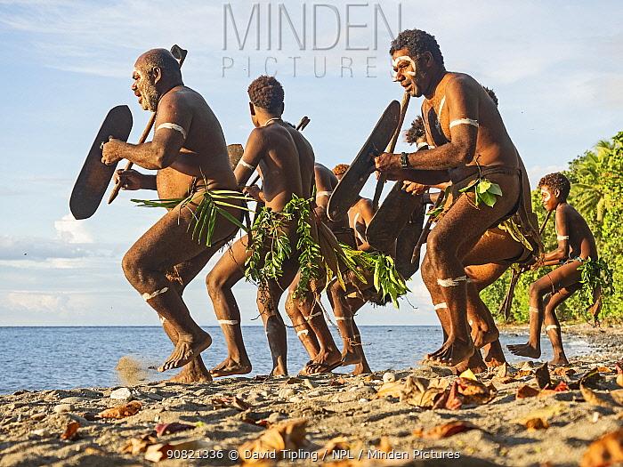 Men performing traditional dance on beach. Savo Island, Solomon Islands.