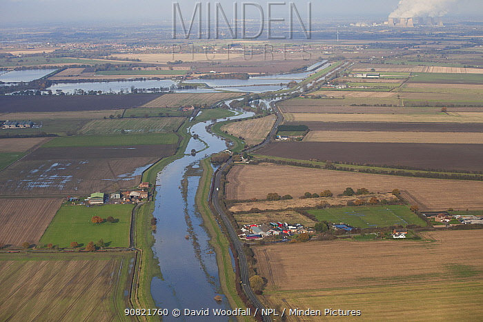 Aerial view of Fishlake, Yorkshire with floods from River Don and Drax coal-powered power station in the distance. November 2019.
