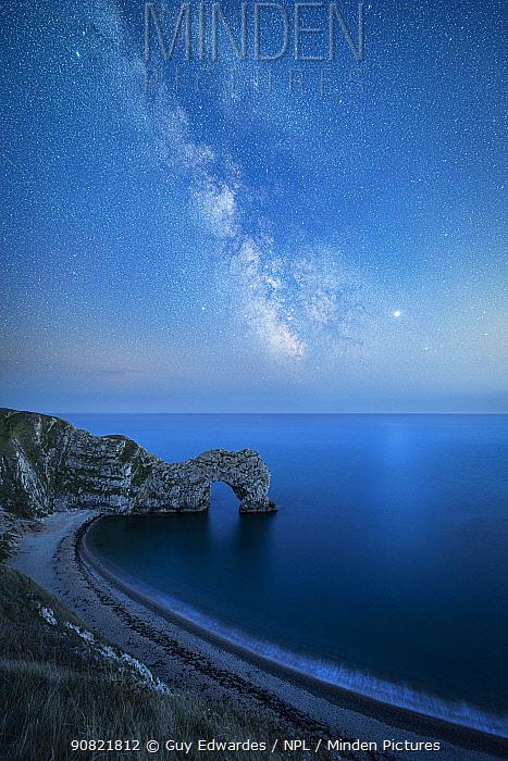 Milky Way above Durdle Door rock arch. Jurrasic Coast, Dorset, England, UK. August 2019. Composite image.