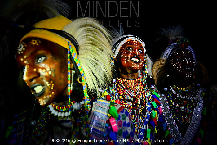 Men from Wodaabe ethnic group dancing with painted faces and in traditional dress. During Gerewol gathering of different clans women choose a husband. Sahel, Africa. 2019. Digital composite.