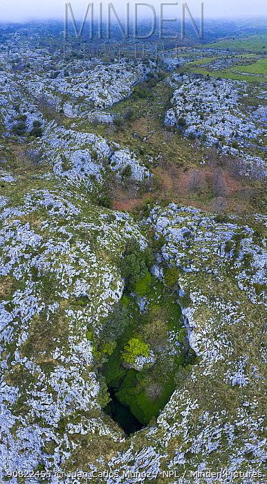 Mortero de Astrana, karst landscape with cave, aerial view. Astrana, Alto Ason, Soba Valley, Cantabria, Spain. April 2019.