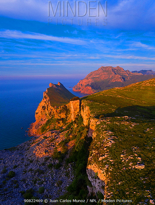 Mount Candina and coastline in evening light. Liendo Valley, Montana Oriental Costera, Cantabria, Spain. May 2019.