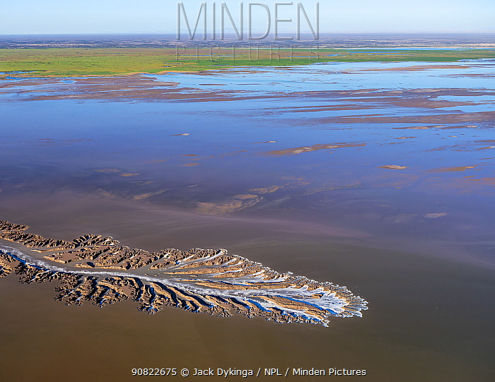 Patterns in the tidal flats of the Colorado River Delta where the delta is swept by tidal encroachment from the Gulf of California. Receding tide causes waterfalls approximately eight feet high, as water pours off the delta and out to sea. Colorado River Delta, Baja California, Mexico. September 2019. Aerial support by LightHawk.