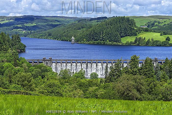 Lake Vyrnwy reservoir with water overflowing dam after heavy rainfall. Llanwddyn, Montgomeryshire, Powys, Wales, UK. June 2019.