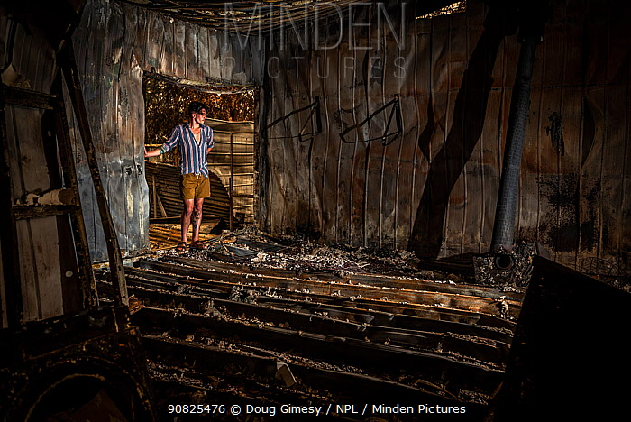 Jeremy Jenkins, seeing his house for the first time after the 2019 / 2020 wildfires destroyed much of the the town of Sarsfield,Victoria, Australia. January, 2020. Editorial use only