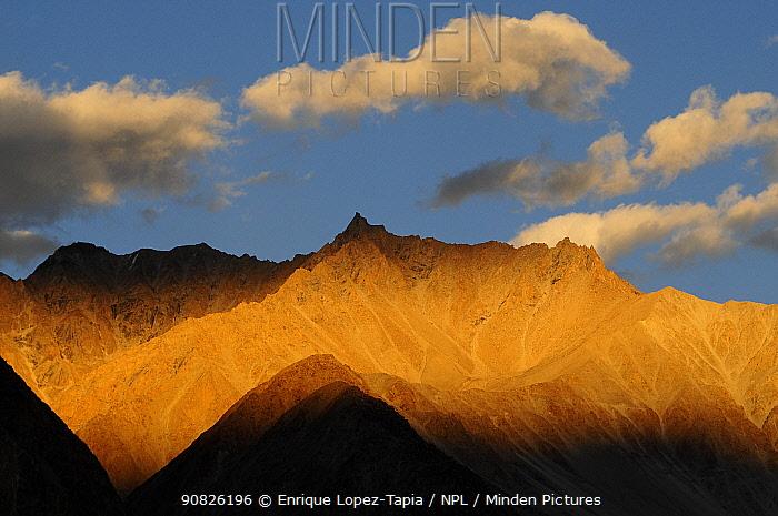 Sunset over the mountains, Nubra Valley, Karakorum Wildlife Sanctuary, Ladakh, India. September 2011.