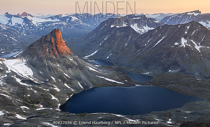 Mount Kyrkja at sunrise, viewed from Visbretinden, Jotunheimen National Park, Norway, July.