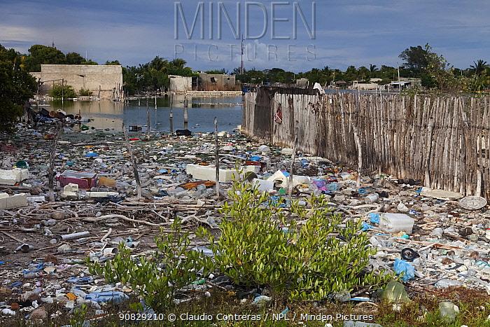 Irregular housing constructed over trash in the coastal lagoon, Ria Celestun, Yucatan Peninsula, Mexico, January