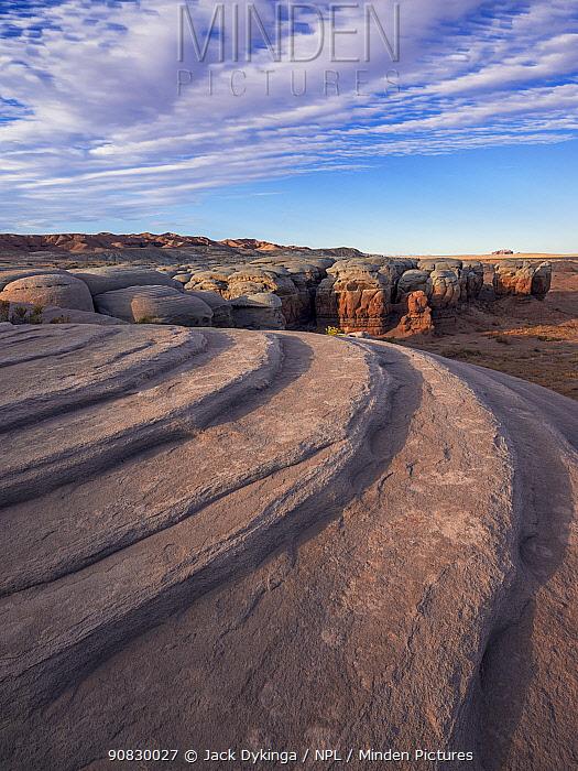 Eroded cap rock of the Curtis formation with Entrada sandstone below, at dawn. BLM Wilderness Study Area, San Rafael Desert, near Hanksville, Utah, USA. 2019.
