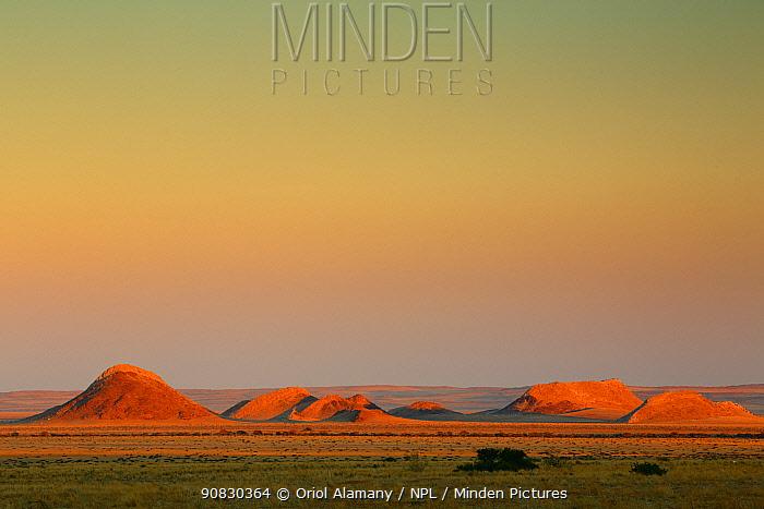Rocky hills at sunrise in the desert near Namib-Nukluft Lodge, Namib-Naukluft National Park, Namibia, October
