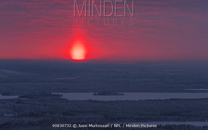 Sunset in winter, Kuusamo, Finland, February.