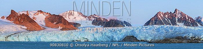 Stitched panorama of the Smeerenburgbreen Glacier at sunset. Mountains viewed from Smeerenburgfjorden / Bjornfjorden. Svalbard, Norway. September.