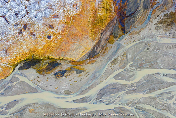 Aerial view of Arctic river delta in autumn, with abstract patterns. Adventdalen valley, Svalbard, Norway.