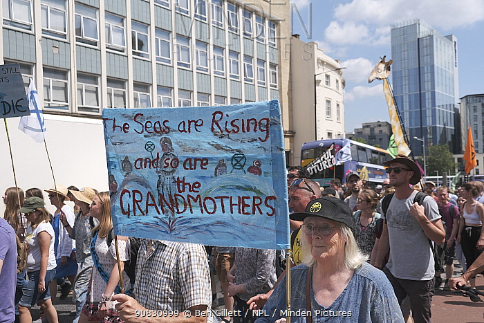 'The seas are rising and so are the grandmothers' banner at Extinction Rebellion climate change protest march. Bristol, England, UK. 16 July 2019.