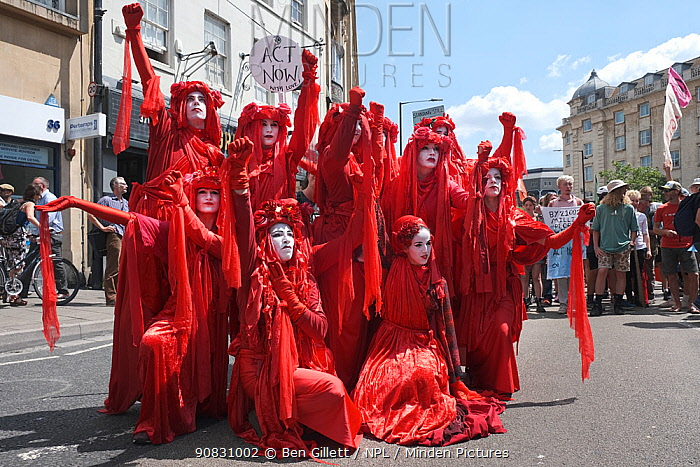 The Red Brigade performance artists at Extinction Rebellion climate change protest. Bristol, England, UK. 16 July 2019.