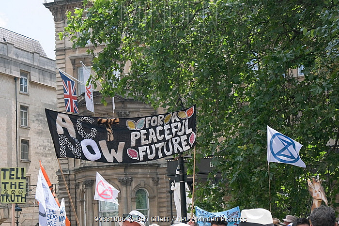'Act now for a peaceful future' banner. Extinction Rebellion climate change protest march. Bristol, England, UK. 16 July 2019.
