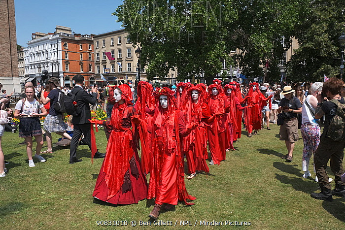 The Red Brigade performance artists at Extinction Rebellion protest rally. Bristol, England, UK. 16 July 2019.