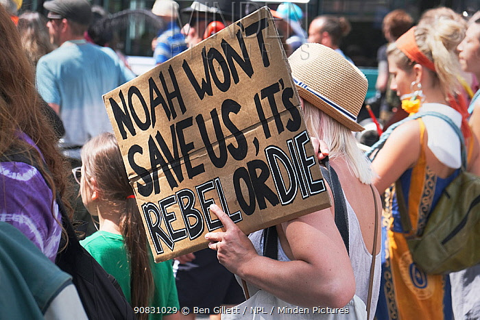 'Noah won't save us, it's rebel or die' placard held by protestor. Extinction Rebellion march and rally, Bristol, England, UK. 16 July 2019.