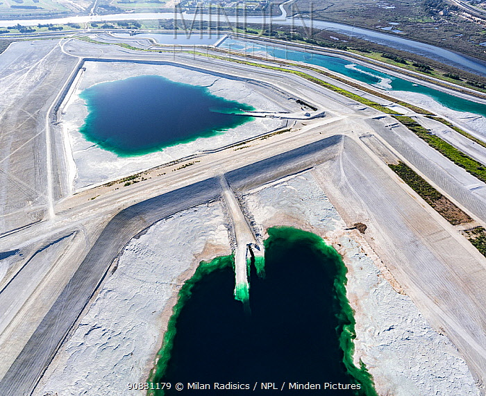 Abandoned pond used for the disposal and stacking of phosphogypsum. Huelva, Southern Spain. Saltmarshes of the Rio Tinto estuary surround the pond. Phosphogypsum is a radioactive by-product in the manufacture of phosphoric acid, used for phosphate-based fertilizers.
