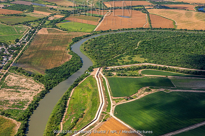 Rio Grande, the border between Tamaulipas, Mexico and USA. Border wall on USA side of river, aerial view. Lower Rio Grande, Texas, USA. July 2019.