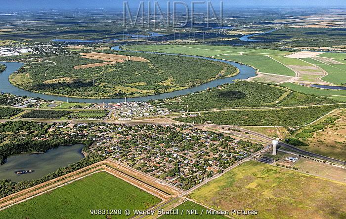 Aerial view of Madero looking across the Rio Grande to Ejido Los Cavazos Tamaulipas, Mexico. Hidalgo County, Texas, USA. July 2019.