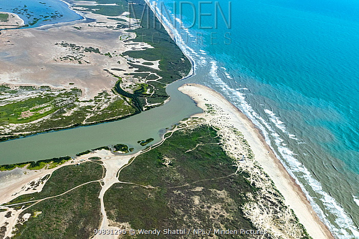 Aerial view of Rio Grande flowing into Gulf of Mexico, the border between Cameron County, Texas, USA and Tamaulipas, Mexico. July 2019.