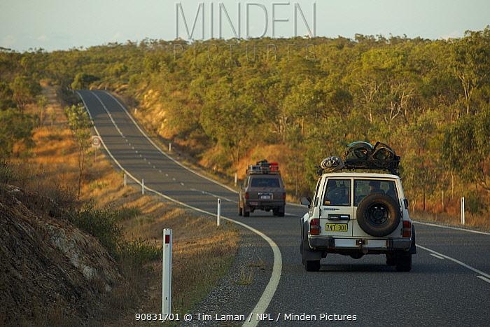 Cars driving along Peninsula Development Road north of Palmer River Roadhouse. Cape York Peninsula, Queensland, Australia. August 2012