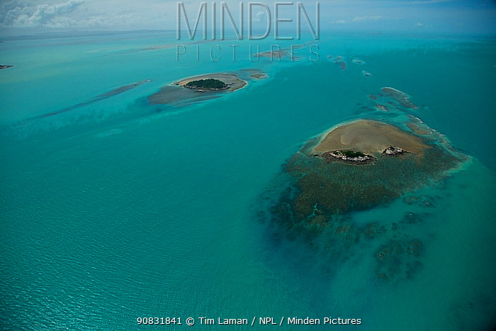 Aerial view of small uninhabited islands of the Torres Strait, surrounded by reefs and turquoise water. Australia. June 2012