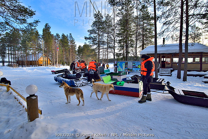 Group of people in front of diving center 'The Arctic Circle' in Nil'moguba Karelia, Russia. White Sea.
